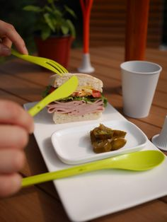http://www.the-reflect.com/  a plastic spoon,a plastic knife, a plastic fork, a plastic stand and a plastic cup