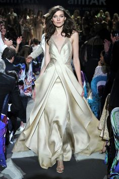 Image from http://www.iwanttobearoitfeld.com/picture/kati_nescher_armani_prive_carine_roitfeld_ultimate_gold_collection_cannes_2013.jpg?pictureId=18077087&asGalleryImage=true.