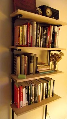 DIY shelves made with plumbing pipes and oak boards.