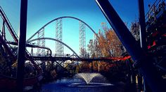 Cedar point roller coaster and fountain in pond