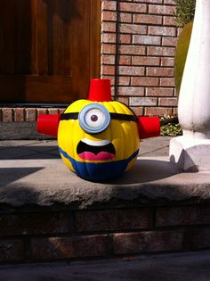 My fiancé is an #FDNY #firefighter and made this #minion #pumpkin for #halloween. #beedo #despicableme   Supplies: -3 empty pudding cups painted red -1 fake craft pumpkin (the kind sold at arts and craft stores) , then he spray painted it yellow. We used a fake pumpkin so that it wouldn't die and we would have it for every year.   -mason jar lid (the eye) -paint -hot glue gun -rubber strap   Assembly is self explanatory as seen in picture. :)  #carlminion