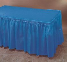 b06e47708 Transform a simple table to an classic and clean look simply by adding a table  skirt. Plastic table skirts offer an inexpensive alternative to traditional  ...