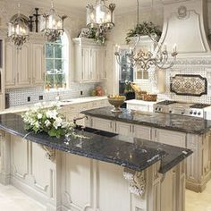 Love the kitchen! I like how they added the  decorative molding to the back of the cabinets on the island rather just a plain panel.