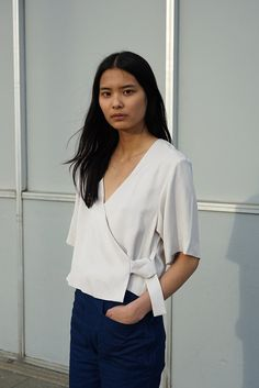 Boxy wrap top with dropped shoulder and elbow-length sleeve. Color: Stone Composition: 100% Tencel Twill
