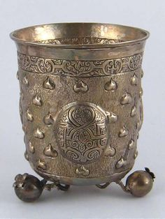 A late 19th. century German white metal, tests silver, beaker on three ball feet