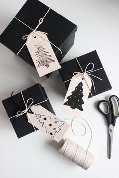 Beautiful wooden gift tags for Christmas or New Years. Love the simple modern designs. You can easily recreate them in just a few minutes! Black and gold are the perfect colours for a New Years Eve party! Merry Christmas, Dark Christmas, Christmas Parties, Christmas Cards, Advent, Cheap Gifts, Wooden Gifts, New Year Gifts, Christmas Wrapping