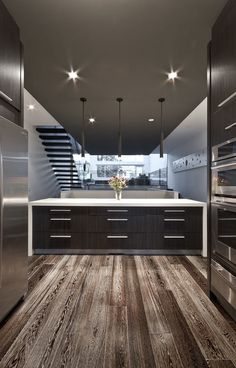 Stunning kitchen! Love the floor & the clean chic lines!!