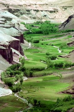 "Remains of the Bamiyan Valley, Afghanistan. What Tariq and Laila might have seen on page 148. ""...carpeted by lush farming fields. Babi said they were green winter wheat and alfalfa, potatoes too. The fields were bordered by poplars and crisscrossed by streams..."""