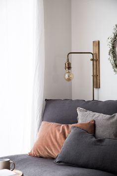 Cosy corner in a minimalist Scandinavian living room / Shades of grey & pastels / IKEA Söderhamn Chaise Longue with a Bemz Loose Fit Urban Cover in Rosendal Linen in Medium Grey