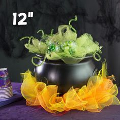 """12"""" Black Witch Cauldron used as a Halloween decoration and candy bowl for a party"""