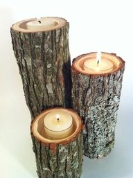 partially hollowed logs turned into candle holders (I ♥ candles)