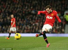 Juan Mata unleashes a typically crisp pass as the Spaniard made his Old Trafford bow against Cardiff City.