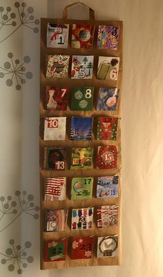 LOVE this, it is brown paper bag cut open so it is long, and then use the little brown lunch bags from the dollar store and cut to make the pockets, and then use old christmas cards as fronts, or make your own something to decorate it with. Fill with candy with a message about Christ, or an ornament for the kids to make. Anything!