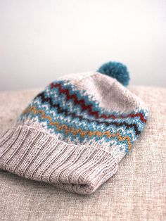 A slouchy hat with a folded brim and stranded pattern to keep your ears warm!  Free pattern