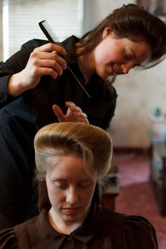 Helen Holm works on Allie Steeds hair. The two young women recently left the FLDS church. photo by Trent Nelson via  gettin BIG