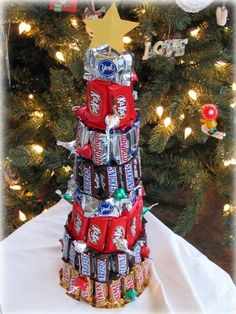 Candy tree (If you have a styrofoam cone, a low-temp. hot glue gun, and some candy, then you have all the trimmings for this edible tree. To finish off, glue a star onto a skewer and poked it through the top of the cone. ) A Christmas tree you can eat! Cool Christmas Trees, Christmas Goodies, Christmas Treats, Winter Christmas, Christmas Candy Crafts, Christmas Potluck, Christmas Decorations, Candy Decorations, Christmas Centerpieces