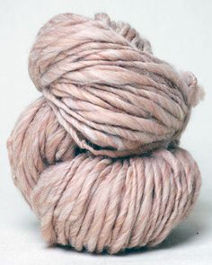 Sister from Knit Collage: Knit Collage's super scrumptious Sister Yarn is a thick and thin yarn that comes in giant 115 yard skeins. These yarns are machine spun and are designed to be knit along with the trim filled Handspun Yarn. The same needle size used for the handspun yarns should also work for the Sister yarns and the colors match perfectly.  The Turquoise Heather pairs up with Mermaid Cafe, the Soft Ivory looks wonderful with Stardust Garland, and the Camel Heather matches up with…