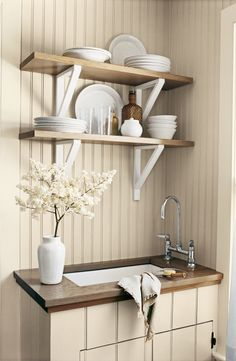 A neutral, natural Ralph Lauren Paint palette creates a peaceful country kitchen