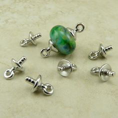TierraCast Basic Cap with Loop Glue-in Finding Description: These glue-in loop sets are so nice for quick and easy lampwork bead connectors. The