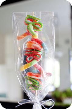 Sour gummies on a BBQ skewer for party snacks- super adorable!