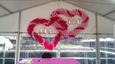 Double Heart balloon sculpture rigged to a marquee canopy