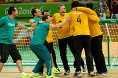 Brazil's players celebrate after defeating Sweden in the men's goalball bronze match during the Rio 2016 Paralympic Games at the Olympic Aquatics Stadium in Rio de Janeiro, Brazil, on September 16, 2016. / AFP / Yasuyoshi Chiba
