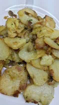 Patatas con berenjena y calabacín al ajillo