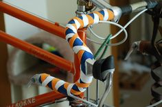 The new bar tape going on. Newbaum's cotton cloth bar tape, orange and white Tsukamaki style over blue base color. Stunt Bike, Stunts, Bicycle, Bike Design, Triathlon, Biking, Cycling, Tape, Wheels