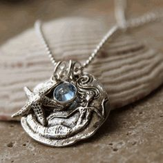 Miss Mermaid Sterling Pendant & Necklace  A FAVORITE!    A sterling silver, round mermaid pendant, starfish and crystal dangles down from a sterling silver ball chain.