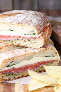 Pressed Italian Sandwiches: Italian meats and cheeses are layered with pesto and fresh basil, then wrapped and pressed in these flavorful sandwiches that are perfect for picnics and parties. recipes for two recipes fry recipes Gourmet Sandwiches, Italian Sandwiches, Cold Sandwiches, Panini Sandwiches, Reuben Sandwich, Best Sandwich Recipes, Sandwiches For Dinner, Italian Panini, Salami Sandwich