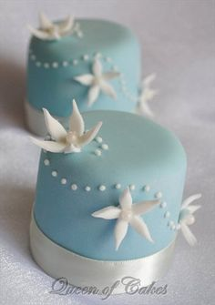 Close-up of blue miniature cakes by Queen of Cakes