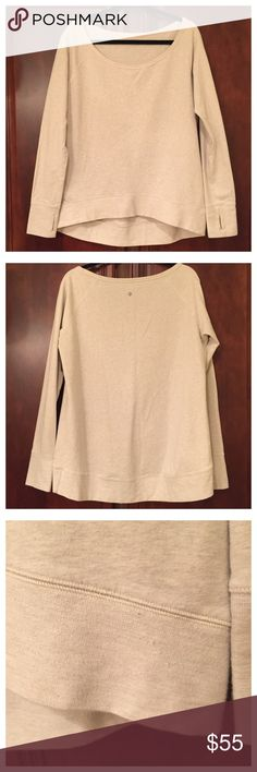 """Lululemon Hi Low Sweatshirt Lululemon Hi Low Sweatshirt is in good condition, a small stain on arm which might come out and some minor pulls , size unknown as tag was cut , I would say between a M to L measures approximately chest 22"""" across, shoulders 19"""" across , No Trades lululemon athletica Tops Sweatshirts & Hoodies"""
