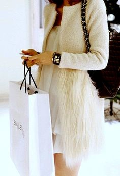 cream jacket with feathers. This would normally be over the top to me, but I think this works. #fashion