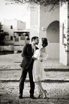 Short, white dress worn during the ceremony. Photography: Christian Oth Studio - christianothstudio.com