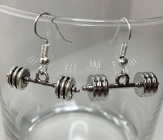 Each pair of earrings represents your unique journey, while being a reminder to never give up! Gifts For Gym Lovers, Gift For Lover, Barbell Earrings, Dangle Earrings, Meaningful Jewelry, Stainless Steel Earrings, Coach Gifts, Dainty Necklace, Earring Backs