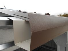 Gusclad Highline gutter - self-hang: fits under metal roof sheeting (box profile).