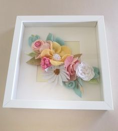 Beautiful handmade felt flower wall art set in a 25 X 25 cm white box frame. Flowers and leaves are hand cut from quality wool felt in pastel colours for a beautiful free standing or wall hanging decoration. Perfect addition to your nursery or girls . Baby Box Frame Ideas, Box Frame Ideas Diy Crafts, Box Frame Art, Box Frames, Craft Ideas, Paper Flower Wreaths, Paper Flower Art, Paper Flower Backdrop, Flower Crafts