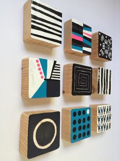 These Set of 9 Modern Scandinavian modern painted wall wood cube sculptures are a perfect art statement for your home, office, corporate offices, commercial lobby, hotel, hospital or any public space. Each piece of wood is hand sawed and hand sanded . Then we apply the acrylic paint by hand. Each painting is then sealed with a top coat to preserve the color and the wood. In the end, the wall sculpture painting is colorful, modern, vibrant, shiny, and unique. Hand-crafted by d.elizabeth…