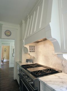 corbels supporting range hood, include metal for hexagonal magnetic spice storage