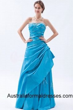 This blue strapless floor-length formal dress is the mixture of elegance and sexiness. The close-fitting upper part and the A-line dress make a strong contrast which will help you show your perfect figure. The strapless and sleeveless designs expose your beautiful shoulders and clavicles. Some exquisite and shinning patterns which are made up of sparkling white beads decorating on blue taffetas making this formal dress high class and unique.