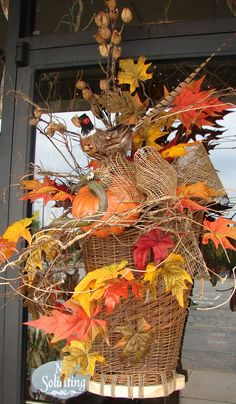Beautiful fall basket.  Great indoors or out!  www.thewhitehare.com