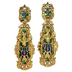 Antique French Enameled Gold Earrings, France Circa 1880 The central polished gold plaques with hand engraved and champleve enameled decorations are set in ornate finely detailed cast frames.     18K gold, marked in several places with French eagle hallmark.