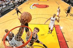 LeBron James blocks a dunk against Tiago Splitter of the San Antonio Spurs during Game Two of the 2013 NBA Finals.