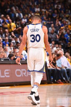 Stephen Curry of the Golden State Warriors walks up court against the Toronto Raptors on October 25 2017 at ORACLE Arena in Oakland California NOTE...