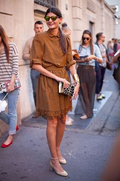 STREET STYLE SPRING 2013: MILAN FW - Giovanna Battaglia is checked in.