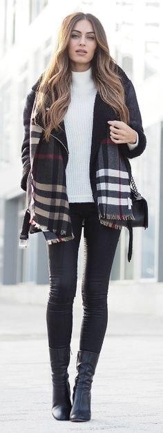 Lydia Lise Millen wears a statement tartan scarf with her black shearling-trim coat.   Knitwear: Laura Scott, Shearling Coat: Old, Scarf: Burberry, Jeans: Missguided, Boots: Chloe.