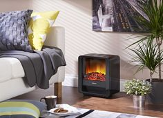 The Mini Cube Portable Electric Fire with Optiflame coal effect in piano black finish has 2 heat settings. And you can use the realistic flames independently of the heat! Electric Fires, Electric Stove, Eating Before Bed, Entertainment Center Decor, Healthy Living Magazine, Furniture Plans, Family Room, Home Appliances, Fireplace Glass