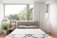 quilt, window above bed, long drapery