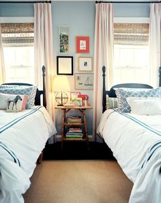 double twin beds, wall arrangement over shared table-boys room