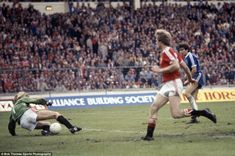 Gordon Smith is foiled by Manchester United goalkeeper Gary Bailey in the final seconds of the 1983 FA Cup final
